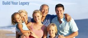 Portrait Of Three Generation Family On Beach Holiday