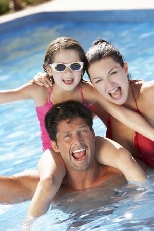 family at swimming pool
